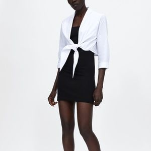 Zara black sheath dress with white shirt overlay